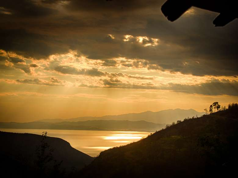 Sunset in Kazaviti with the sea and the mountains of the mainland in the background